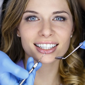 attractive woman smiling in dentist chair