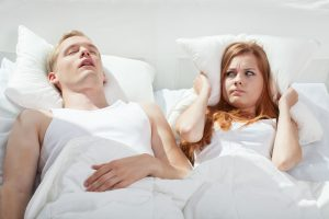 woman disturbed by partner's snoring