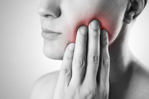 A person with a toothache during COVID-19.