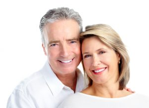 Madison All-On-4 dental implants support full dentures. Dr. John Carollo offers this option to patients wanting secure dentures and youthful looks.