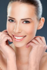Woman with a beautiful smile thanks to the veneers florham park residents love