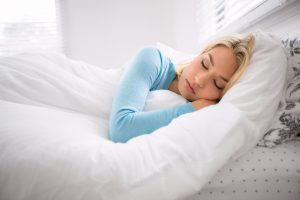 Woman in bed with sleep apnea treatment in Florham Park